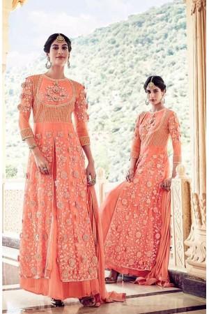 Peach color net party wear lehenga kameez