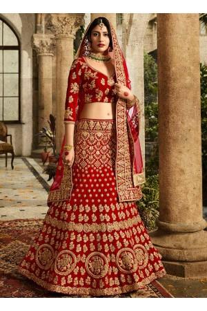 Red and orange silk velvet and net wedding lehenga choli