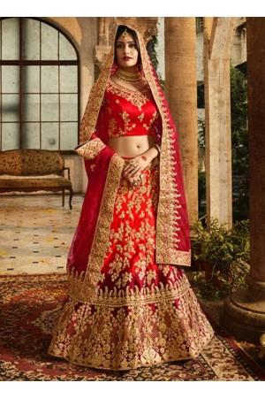 Red and maroon shaded silk velvet and net wedding lehenga choli