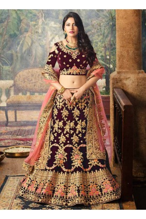 Maroon color velvet and net wedding lehenga choli