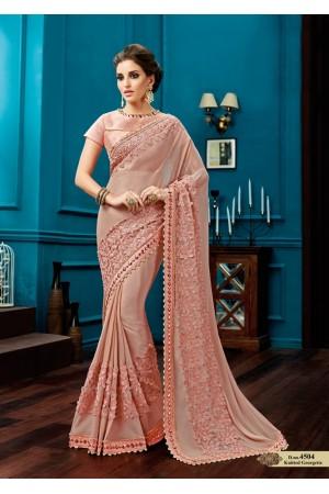 Peach knitted georgette wedding wear saree