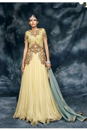 Cream color net wedding wear anarkali suit