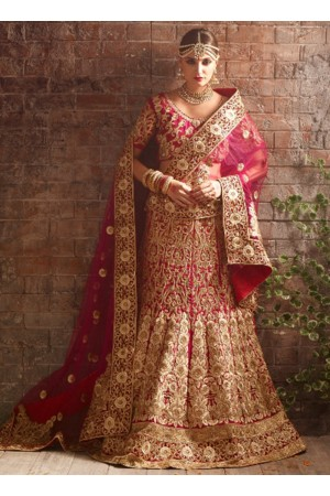 Fushcia color net bridal lehenga choli