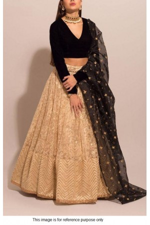 Bollywood model beige and black lehenga choli