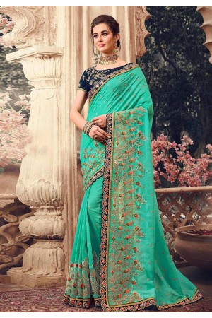 Green silk embroidered party wear saree 1070