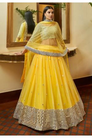 Yellow net mirror work lehenga choli 7306
