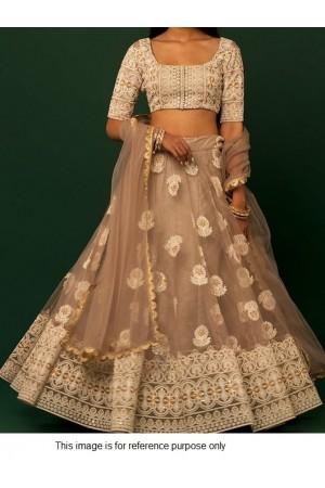 Bollywood model beige lucknowi lehenga