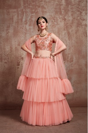 Peach color net Ruffle wedding lehenga