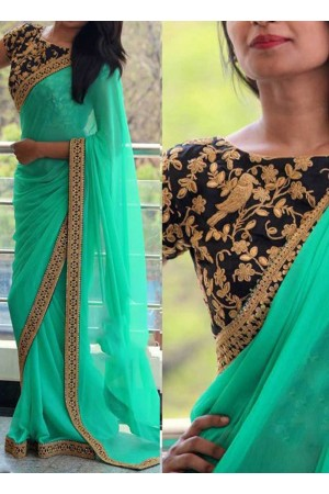 Inspired style Turquoise and black color georgette party wear saree