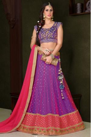 Purple net wedding lehenga choli