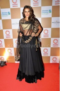 Neha Dhupia black and gold lehenga