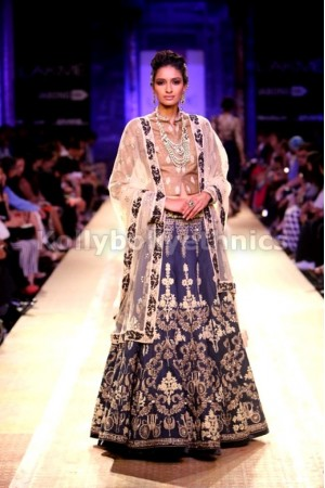 Anju modi navy blue and beige colour bridal lehenga