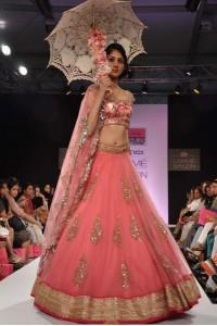 Peach Lakme fashion model Bollywood lehenga