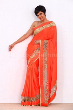 Mandira bedi orange and gold bollywood saree