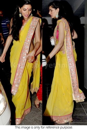 Nargis Fakhri yellow and pink saree