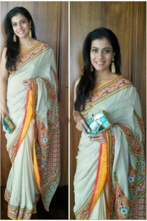 Kajol georgette white and yellow saree