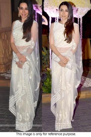 Karishma Kapoor net saree in white colour