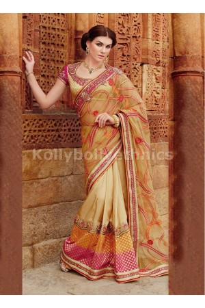 Innovative Cream Net and Tussar Silk Designer Party wear saree