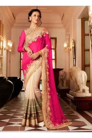 Impeccable Cream and Hot Pink Net Designer Saree