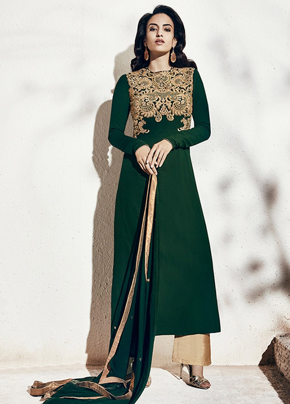 Transform Yourself Into Ethnic Diva Wearing This Bottle Green Color Embroidered Velvet Palazzo Suit Beautified