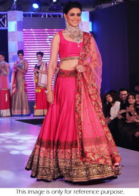 Bollywood Style Genelia Bridal week net lehenga in pink color