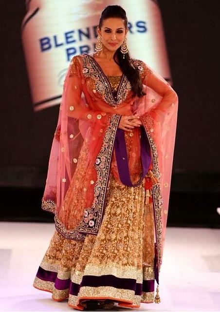 Bollywood Style Malaika arora khan net lehenga in pink and gold color