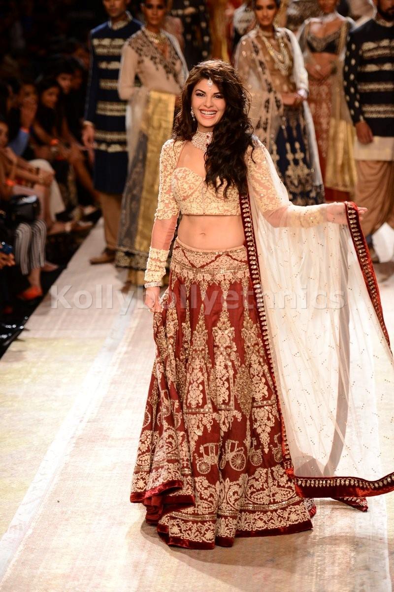 Bollywood Style Jacqualine Fernandz silk and net bridal lehenga choli in Maroon and beige color