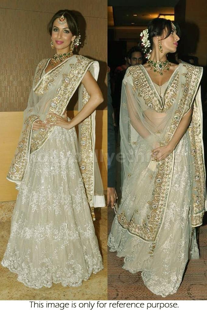 Bollywood Style Malaika Arora khan net lehenga in golden color