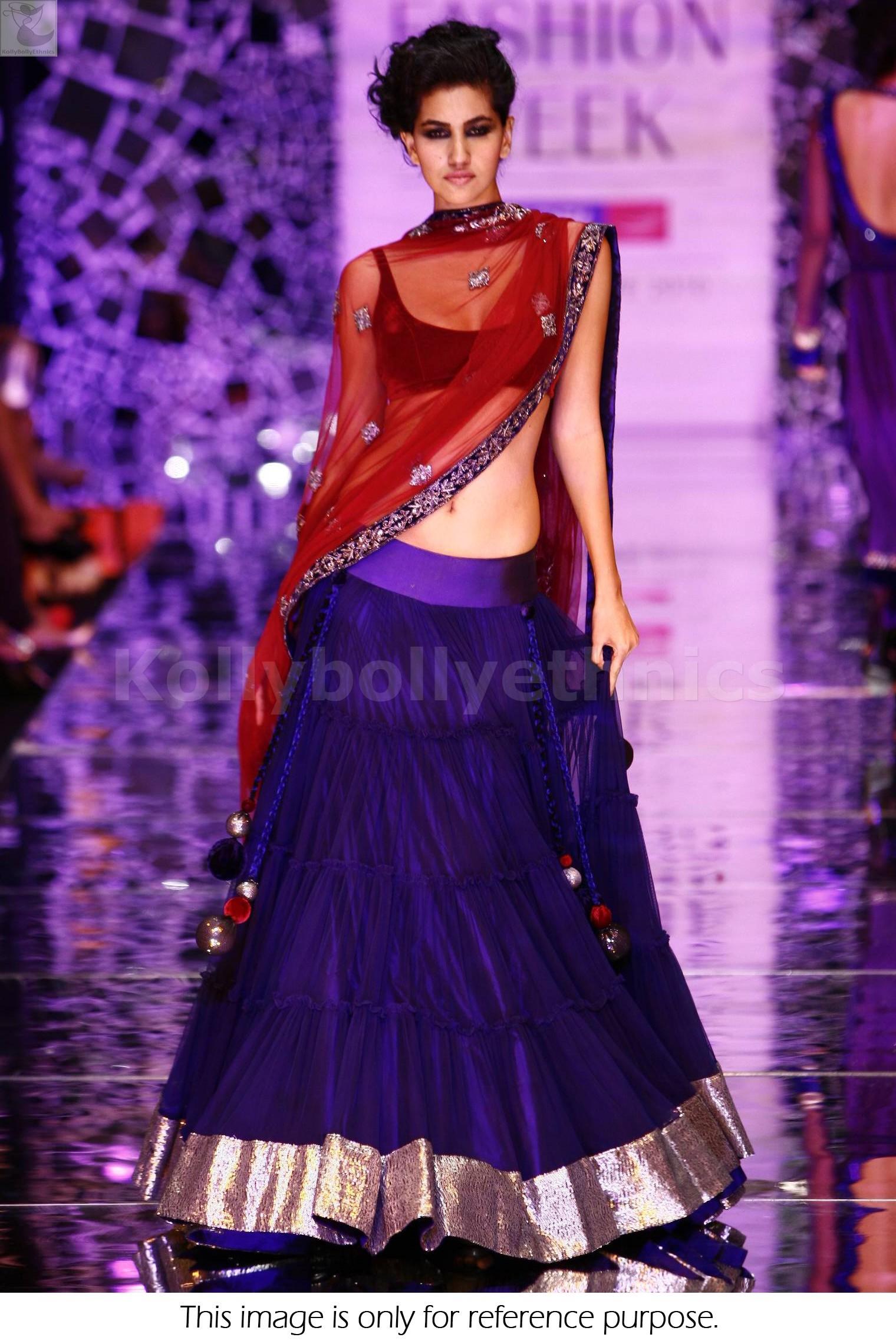 Bollywood Style Lakme fashion week net and velvet lehenga in blue color