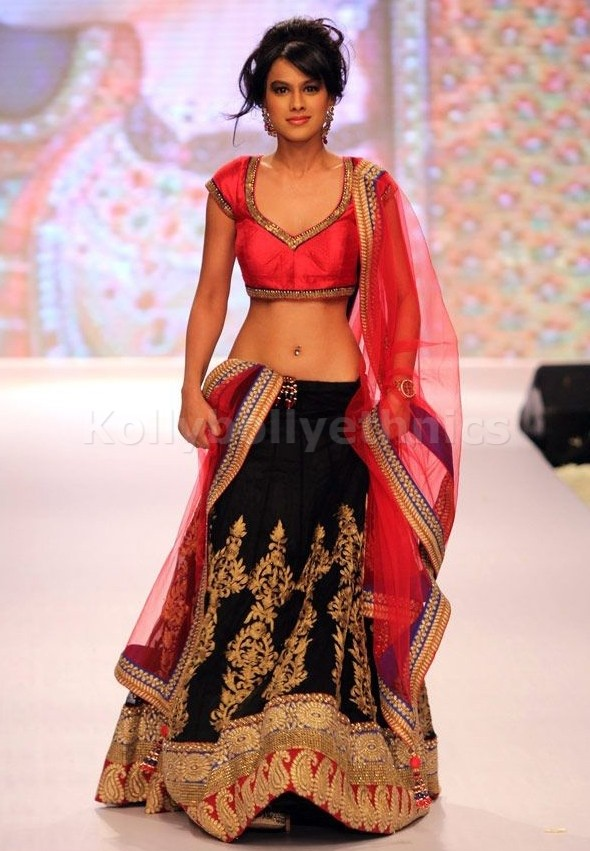 Bollywood Style Nia sharma georgette lehenga in black and pink color
