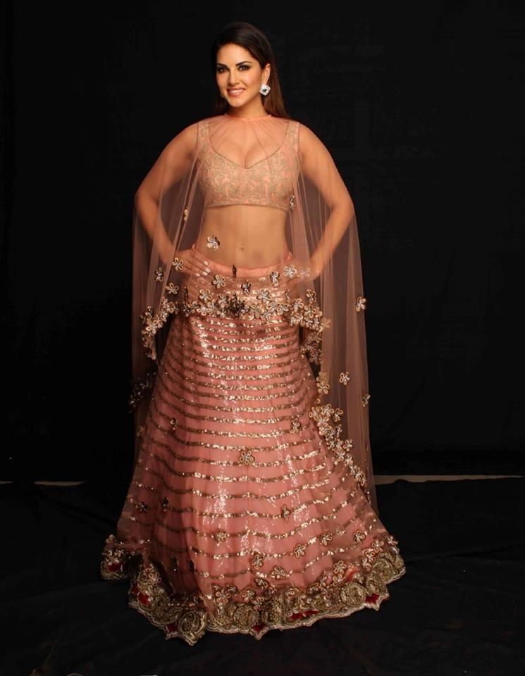 Bollywood Style Sunny Leon peach colour netted lehenga