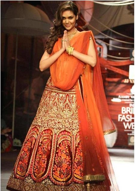 Bollywood Style Esha Gupta velvet Bridal lehenga in red and orange color