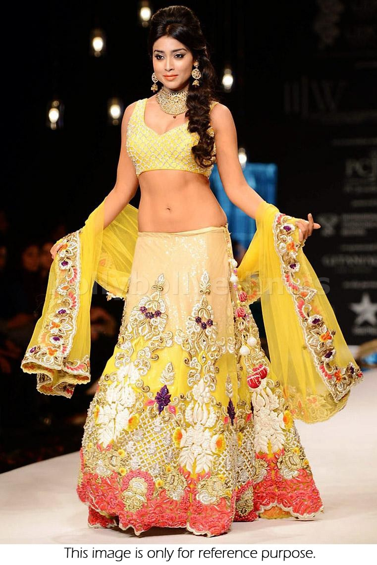 Bollywood Style Shriya Saran georgette lehenga in yellow and gold color