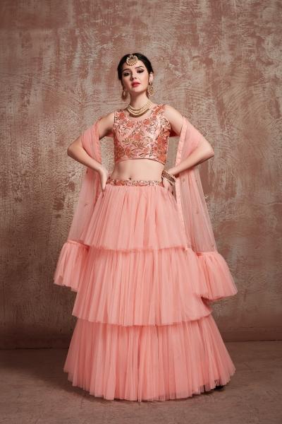 Peach color net Ruffle wedding lehenga