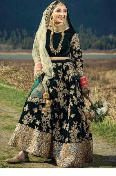 Bollywood model Dark green velvet mirror lehenga