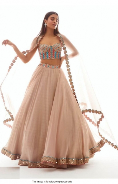 Bollywood model peach net wedding lehenga
