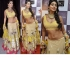 Shriya Saran yellow and gold bollywood Lehenga