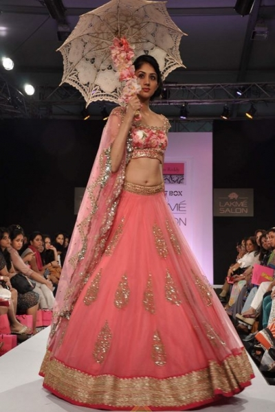 Peach Lakme fashion model Bollywood lehenga