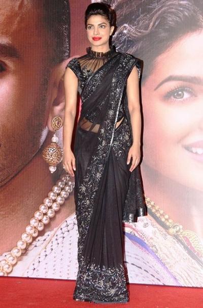 Priyanka chopra black color netted bollywood saree