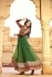 Green and red color netted party wear anarkali suit