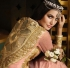 Peach color netted trail type party wear anarkali suit