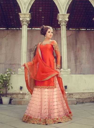 Orange and peach silk and net wedding wear lehenga kameez