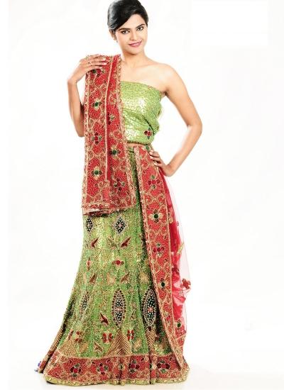 Green and red net designer wedding lehenga