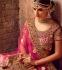 Fushcia color net bridal lehenga choli