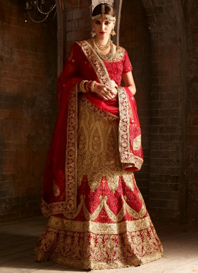 Crem and red net bridal lehenga choli
