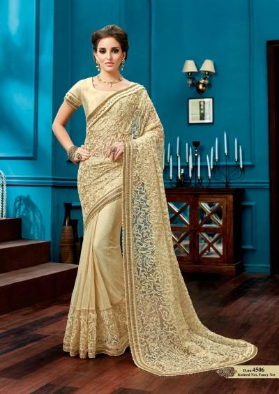 Off white knitted net wedding wear saree