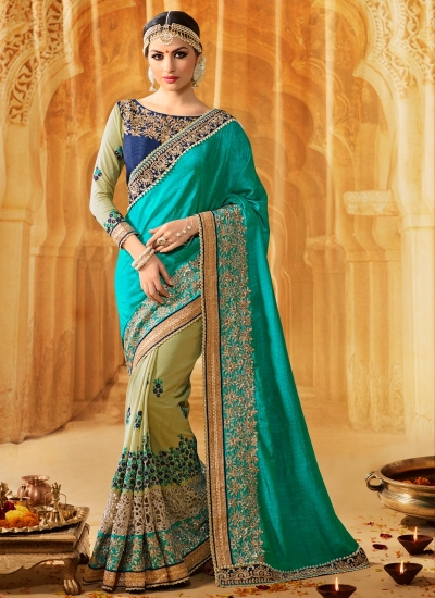 Turquoise art silk wedding wear saree