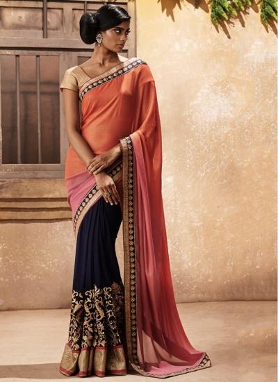 Flamboyant Navy Blue and Orange Zari Work Georgette Designer wedding wear saree