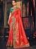 Orange and green Banarasi pure silk wedding wear saree