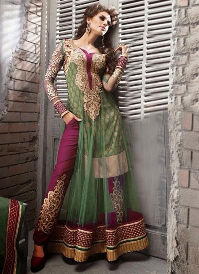 Mesmerizing green and red heavy designer stone work wedding wear salwar kameez